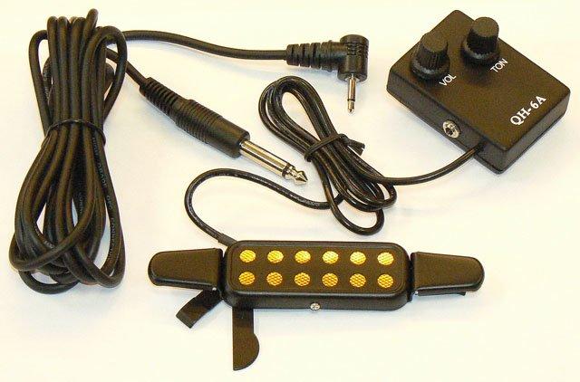 Звукосниматель.  Крепится в отверстие резонатора.  Не нарушает акустических свойств гитары.